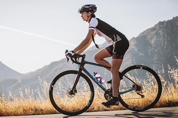 Woman cycling on a Liv road bike