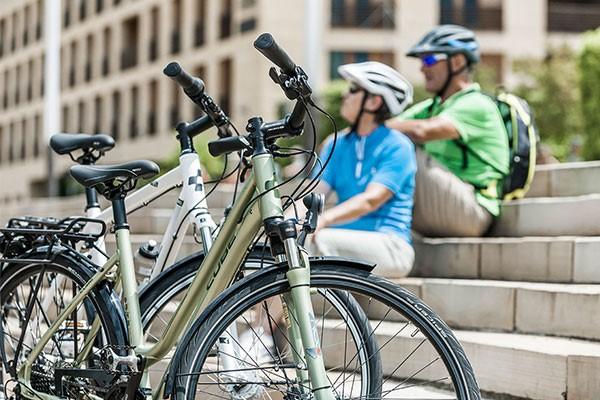 Urban cyclists with a Cube hybrid bike and a Cube step through hybrid bike