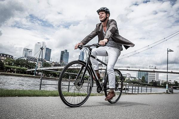 Urban cyclists riding a hybrid bike in a city