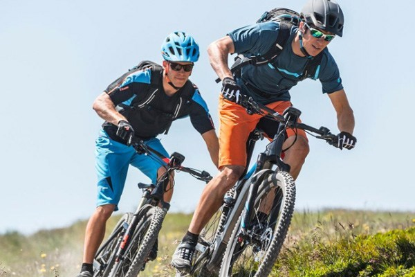 Two mountain bikers wearing summer jerseys