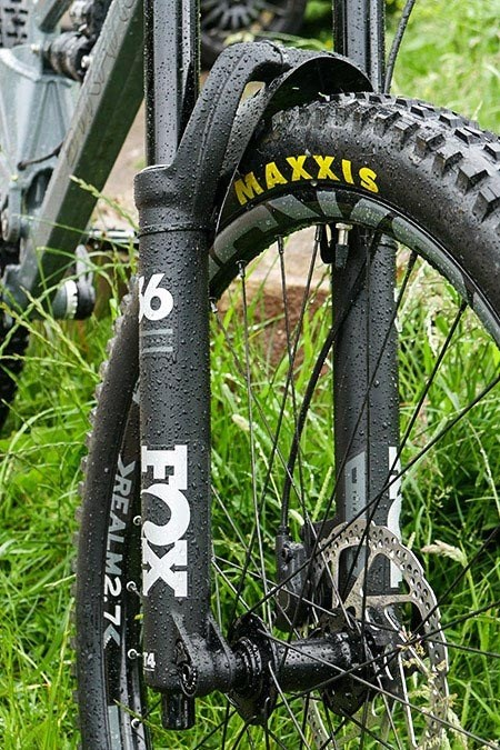 Close up view of the Fox front Suspension forks and Maxxis tyres