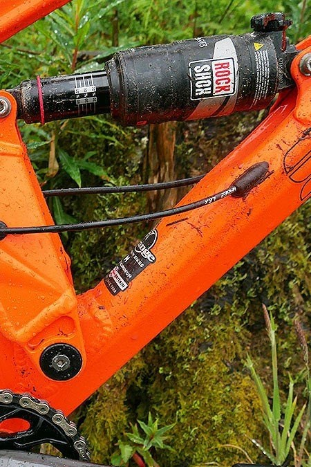 Close up side view of a rear Rockshox suspension