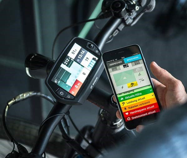 a eBike rider checking out his stats of his ride on his smartphone