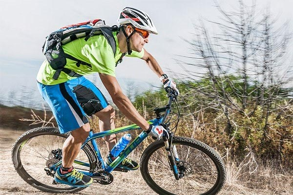 Mountain Biker in action wearing a backpack