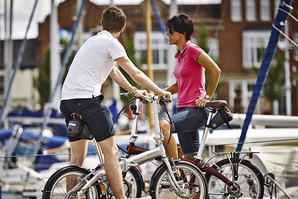 Couple on leisure ride with compact folding bikes