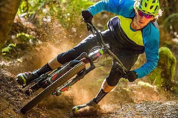 mountain biker shredding a turn