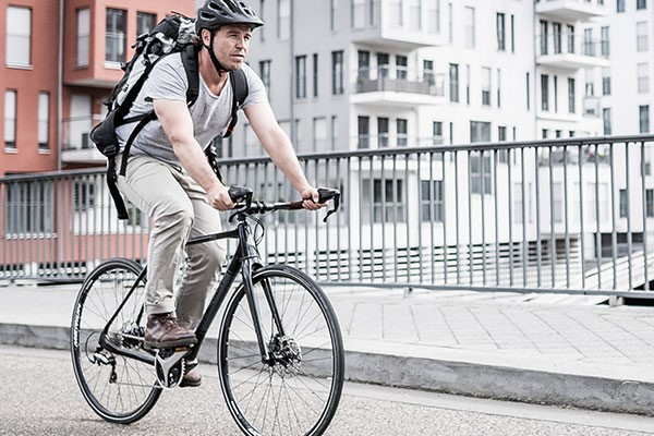 Urban cyclist on a hybrid bike under £500