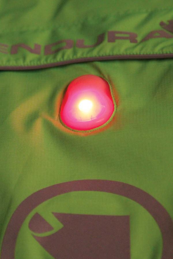 Luminite jacket with integrated rear light