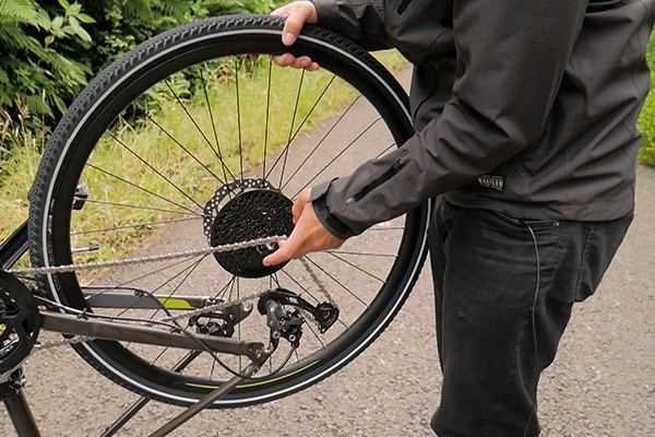 Reinstall wheel onto bike