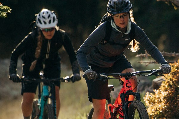 two women riding Cannondale mountain bikes