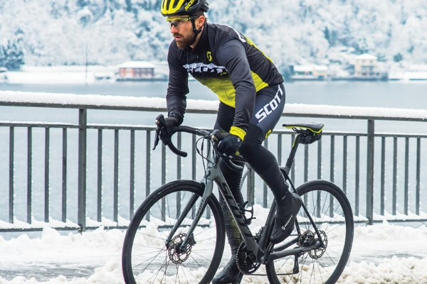 Cyclist wearing thermal bib tights in heavy snow