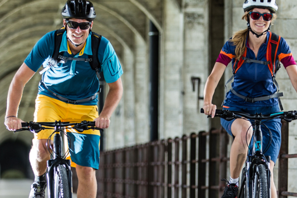 Commuters wearing bright coloured, loose fit jerseys
