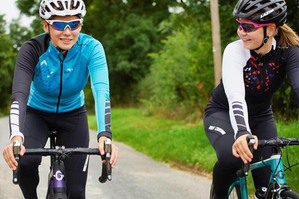 Road cyclists wearing long sleeve jerseys