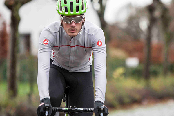 Road cyclist wearing a winter jersey