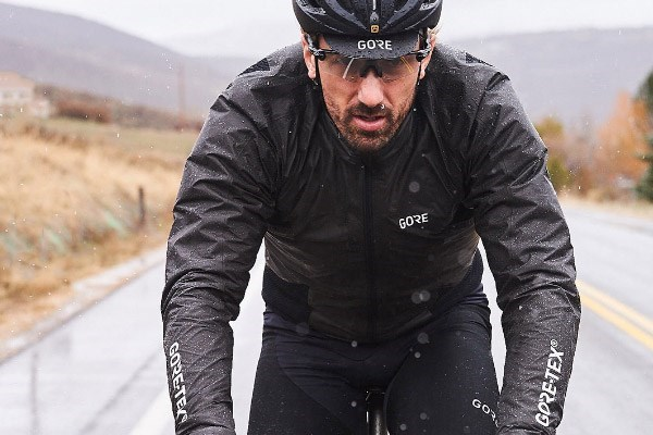 Cyclist wearing a waterproof cycling jacket