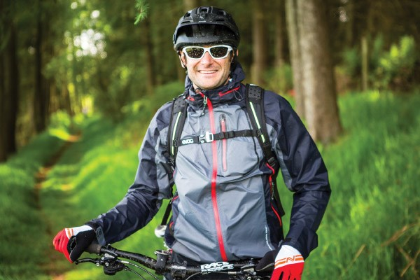 Cyclist wearing waterproof jacket