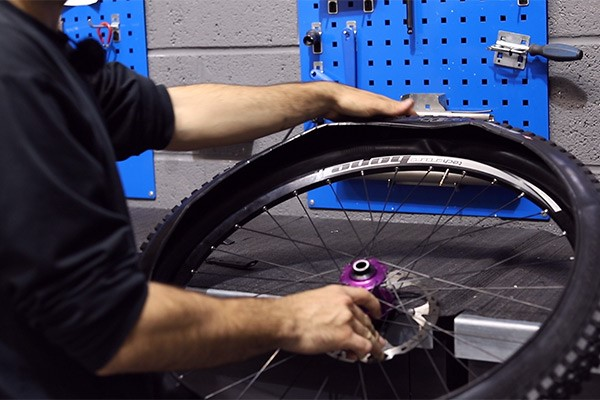 Install one side of tyre into your bike rim
