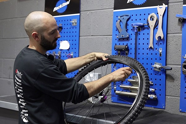 Install other side of tyre into your bike rim