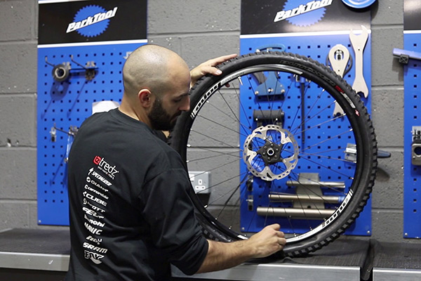 Rotating bike wheel to help tyre sealant set