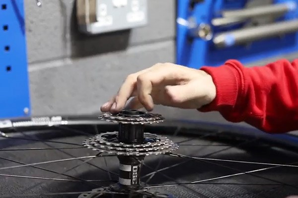Place cogs onto freehub