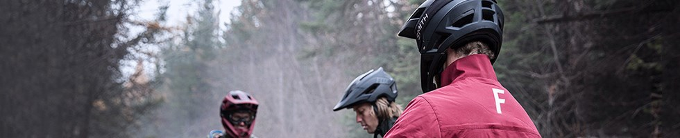 Rear view image of a Mtb'er in a helmet