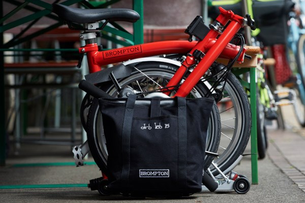 Brompton have a variety of luggage options. Either mounted to the headtube or to a rear luggage rack.