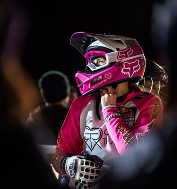 Downhill rider fastening their chin strap