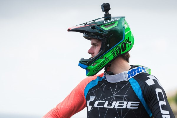 Mountain biker with GoPro mounted to a full-face helmet