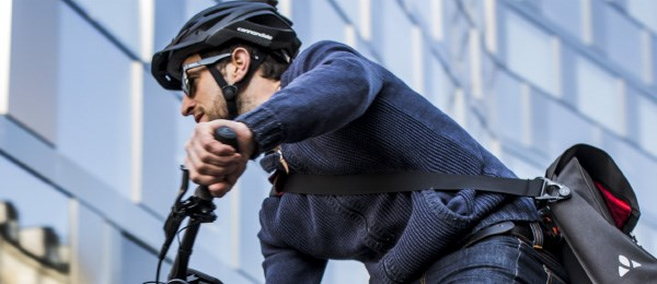 A close up view of a urban commuter on his way to work wearing a helmet