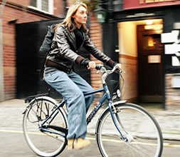 Female cyclist riding a Dawes ladies hybrid bike