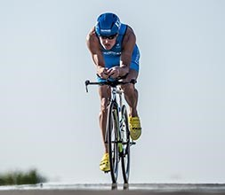 Triathlete riding on a triathlon bike
