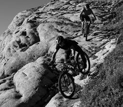 riding Norco mountain bikes down a slab