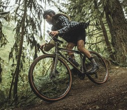 riding a Norco gravel bike in the woods