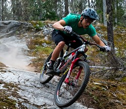Riding a Norco mountain bike