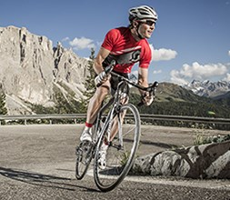 Road cyclist wearing lycra Scott bib shorts
