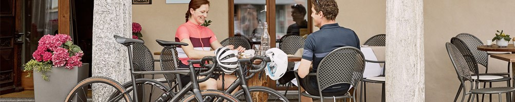 Two cyclists taking a break at a cafe