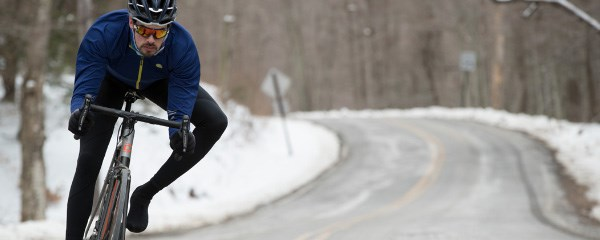 Road cyclist on snow conditions