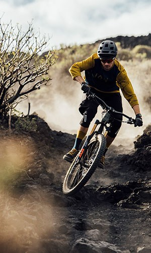 A mountain biker wearing ION Scrub clothing