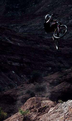 A mountain biker wearing ION Seek clothing