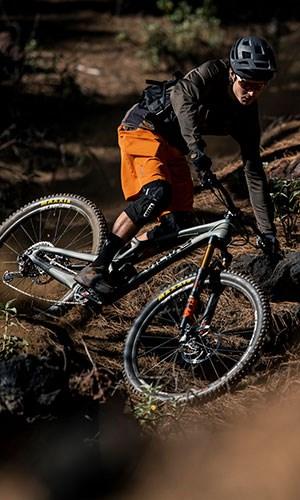 A mountain biker wearing ION Traze clothing