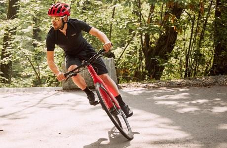 Cyclist taking a corner on a BMC Alpenchallenge