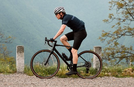 A cyclist riding over gravel on the BMC Roadmachine
