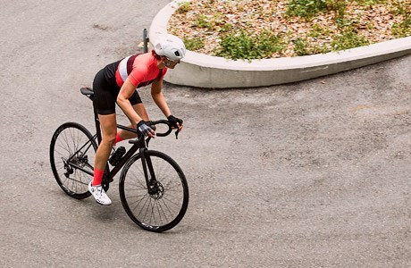 A road cyclist going around a hairpin bend on the BMC Teammachine