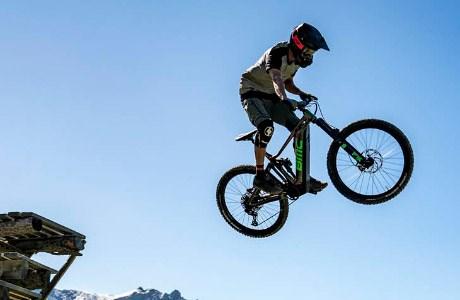 A mountain biker launching a jump on the BMC Trailfox AMP