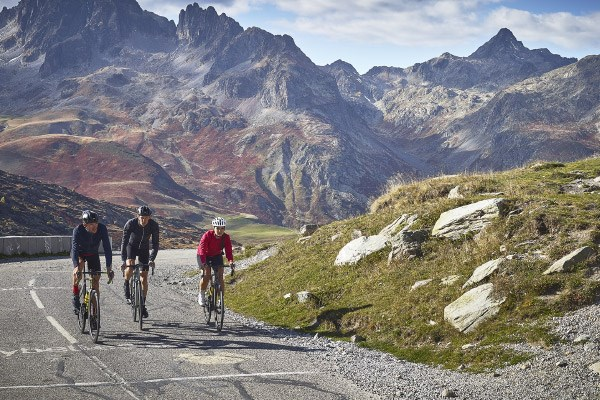 A group of cyclists ascending a French mountain road using Mavic components and apparel