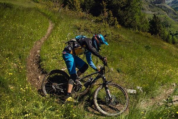 Enduro mountain bike rider on single track trail