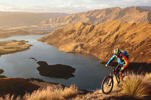 A mountain biker at the top of a scenic climb
