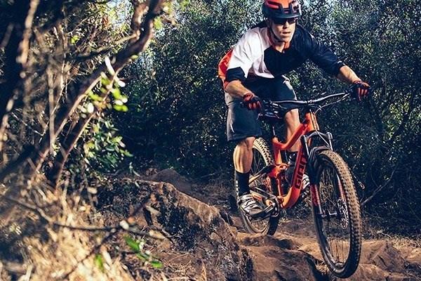 mountain biker riding over rocky ground