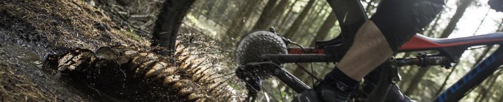 Mountain biking in the mud with a mudguard