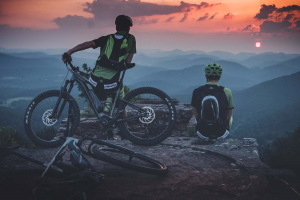 Mountain bikers watching a sunset